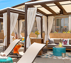 Paloma Pool Cabana with lounge chairs at Kona Kai Resort.