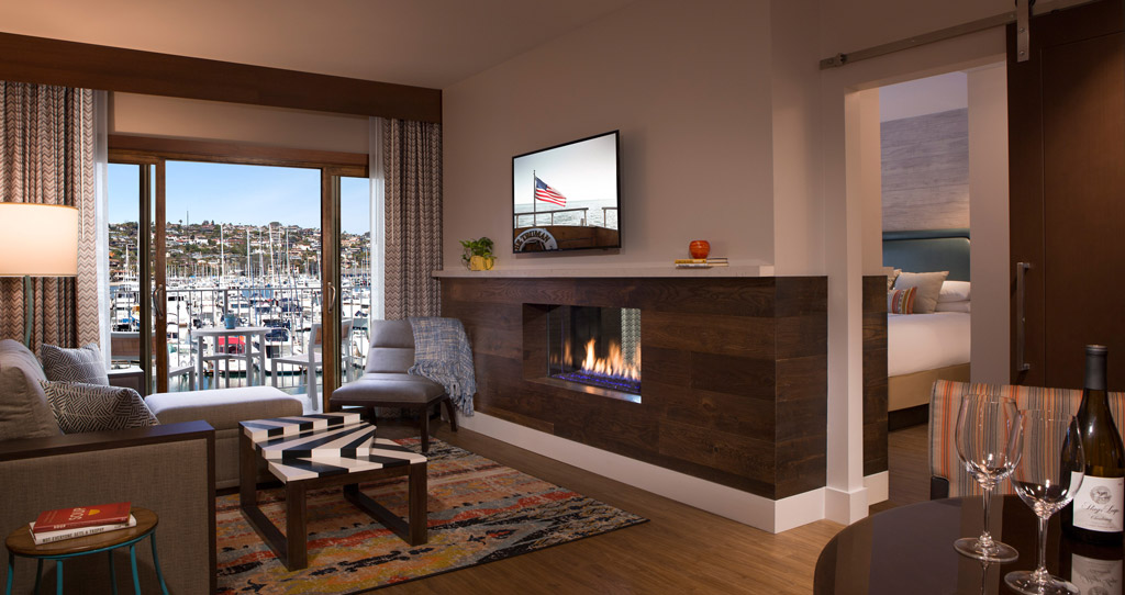 Two bedroom suite living room with a view of the marina and fireplace.